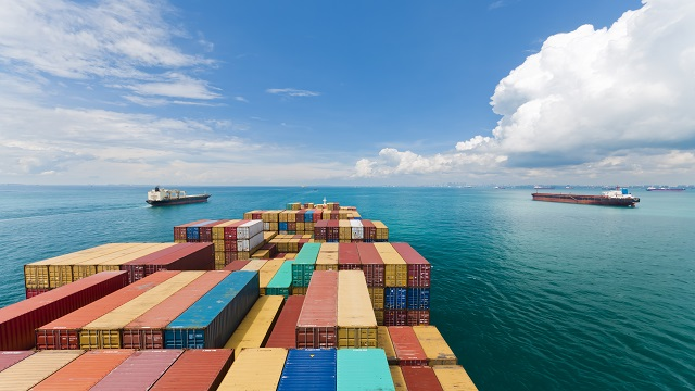 shipping containers on ship on ocean